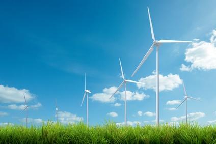wind turbine with grass and blue sky